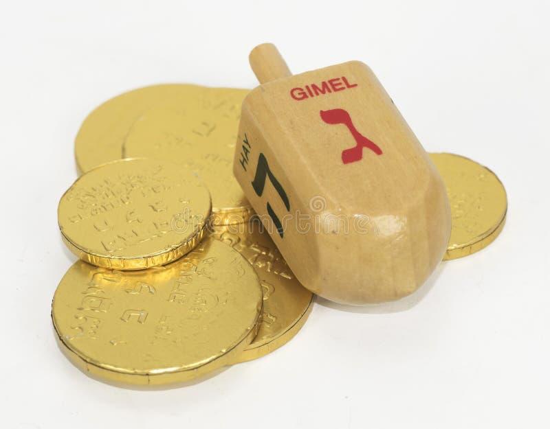 Hanoukka Dreidel et pièces de monnaie de chocolat image stock