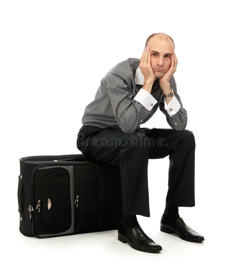 hans bagagemansitting arkivbild
