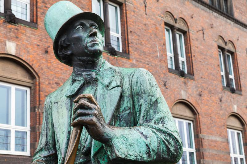 Hans Christian Andersen statue. Denmark. Hans Christian Andersen is sitting in the City Hall square in the form of a large statue. The Bronze statue was made by royalty free stock images