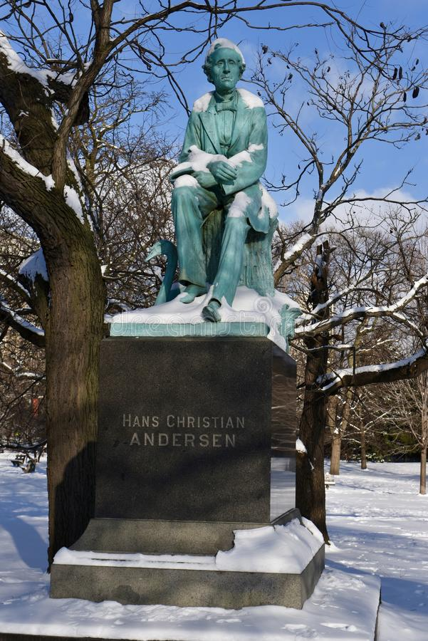 Hans Christian Anderson. This is a Winter picture of the iconic sculpture of the Danish storyteller Hans Christian Anderson enhanced by freshly fallen snow royalty free stock photo