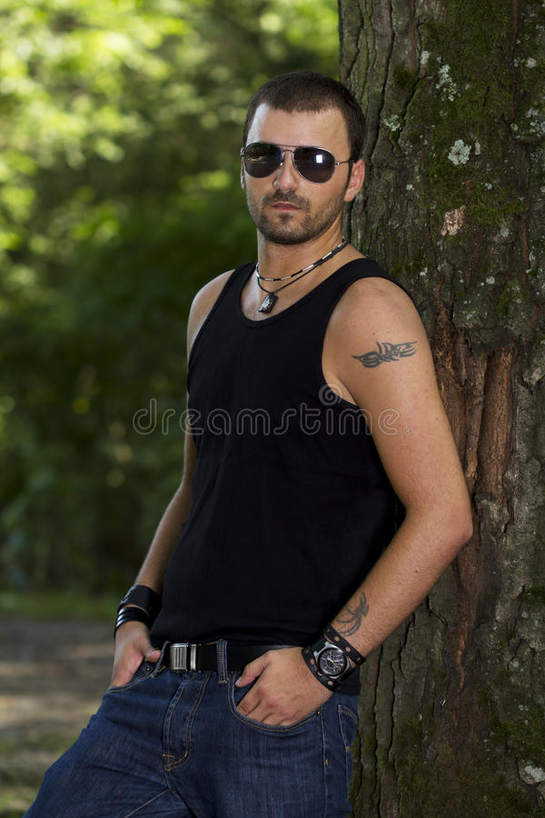 Download Hansom young man in forest stock image. Image of tattooed - 26166219