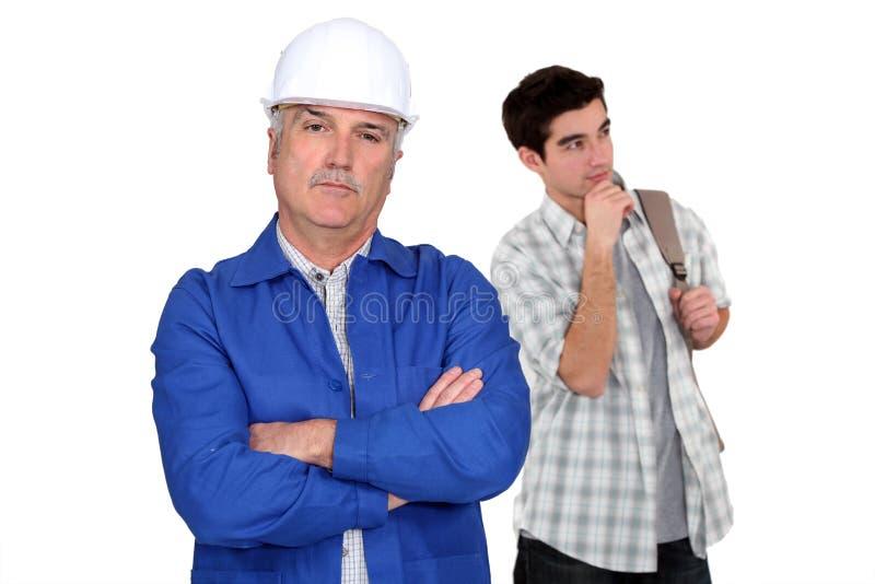 Hantverkare och student royaltyfri bild