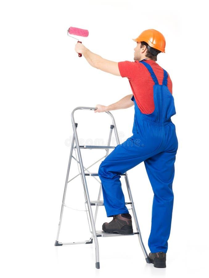 Hantverkaremålaren står på trappan royaltyfria foton