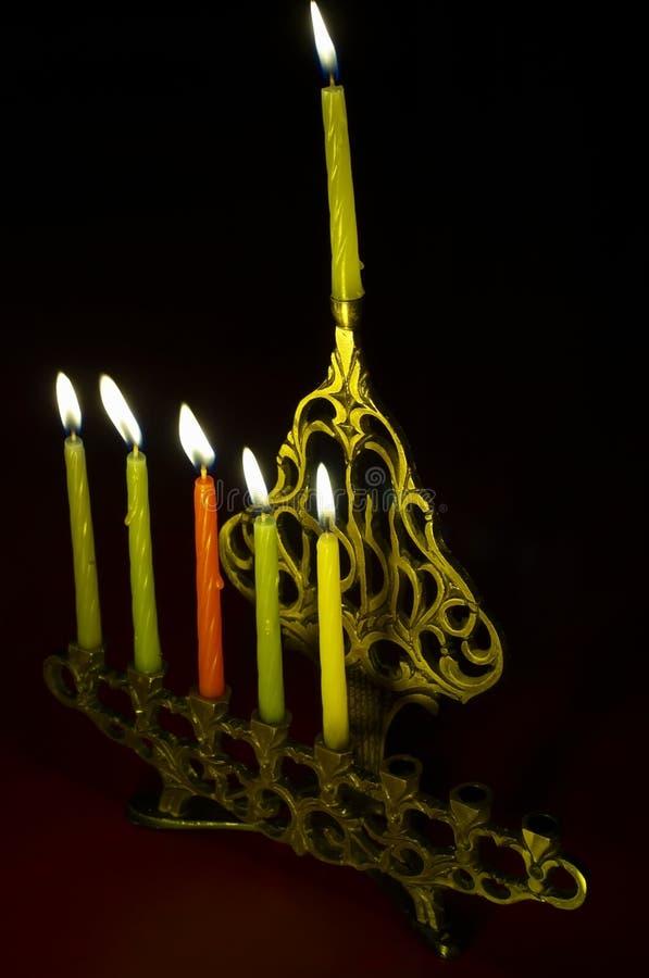Hanuka candles in hanukkiya. Fifth day stock photography