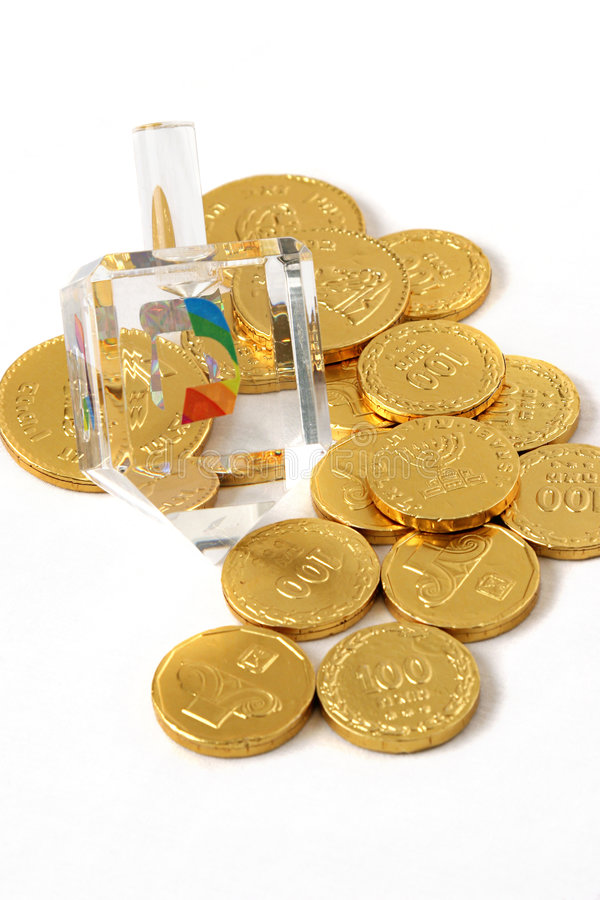 Hanukah en cristal Dreidel et Gelt photo stock