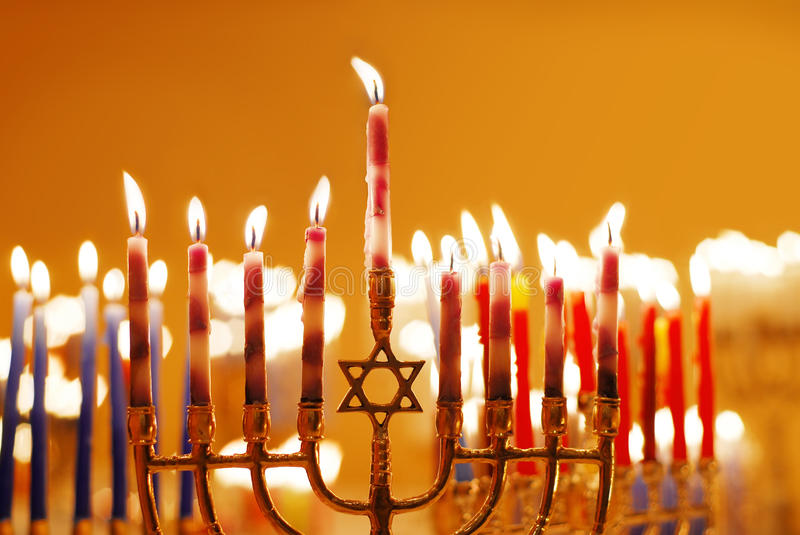 Hanukkah Candles. Brightly lit grouping of menorahs on the eighth night of Hanukkah