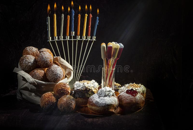 Hanukkah, candlestick, buns. Everything for a holiday with family and for guests. Joy and happiness. Hanukkah, candlestick, buns. Everything for a holiday with royalty free stock photo
