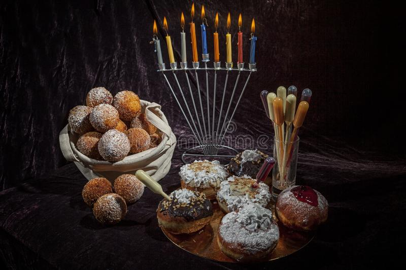 Hanukkah, candlestick, buns. Everything for a holiday with family and for guests. Joy and happiness. Hanukkah, candlestick, buns. Everything for a holiday with stock photo