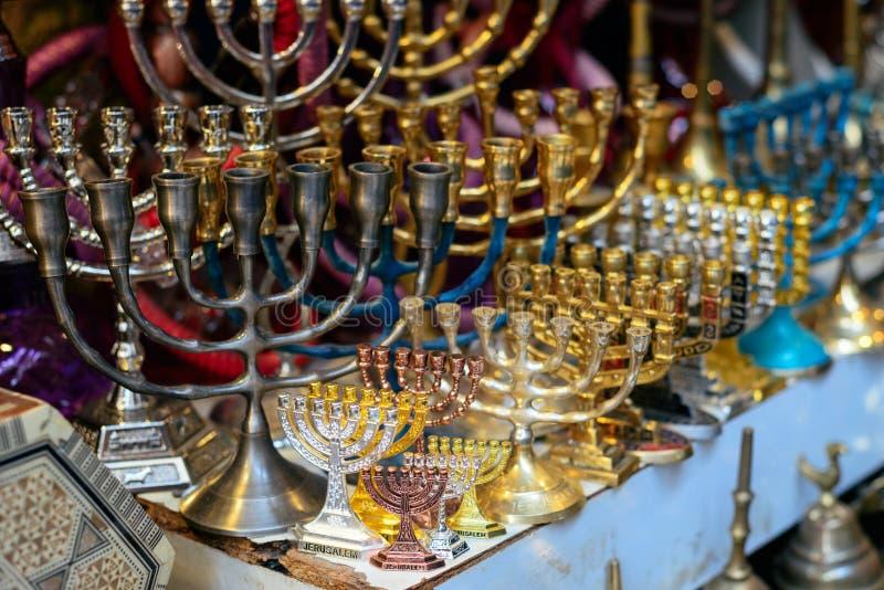 Hanukkah candlesticks on Jerusalem souvenir store. The market of Jewish souvenirs royalty free stock photo