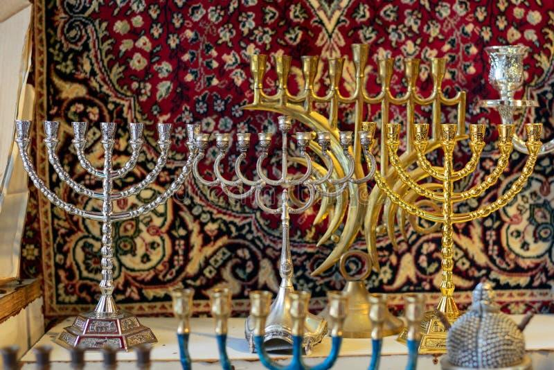 Hanukkah candlesticks on Jerusalem souvenir store. The market of Jewish souvenirs stock image