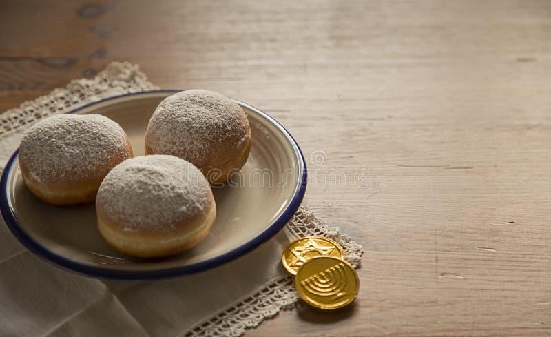 Hanukkah celebration concept-closeup of donuts and chocolate coi stock photo