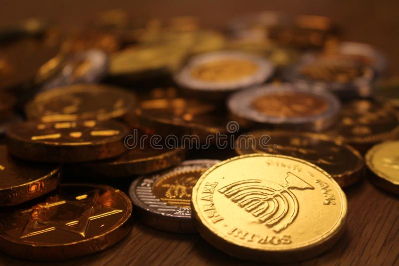 Hanukkah chocolate coins with menorah symbol on back for Judaism. Hanukkah chocolate coins with menorah and star of David symbol on back for Judaism royalty free stock photo