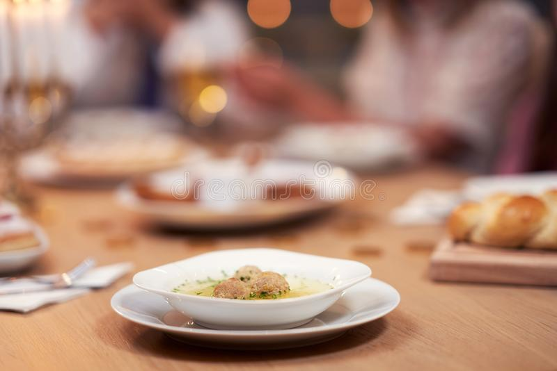 Hanukkah dinner. Family gathered around the table with traditional dishes royalty free stock photos