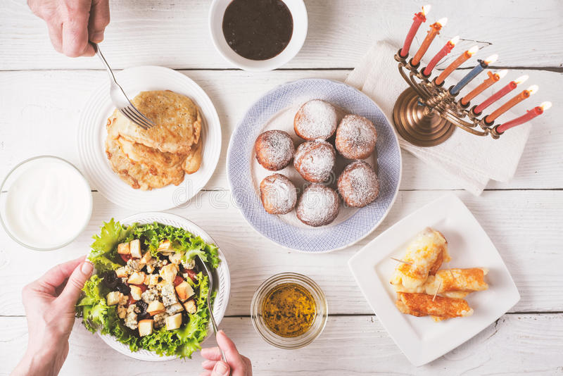 Hanukkah dinner with traditional dishes top view stock photo