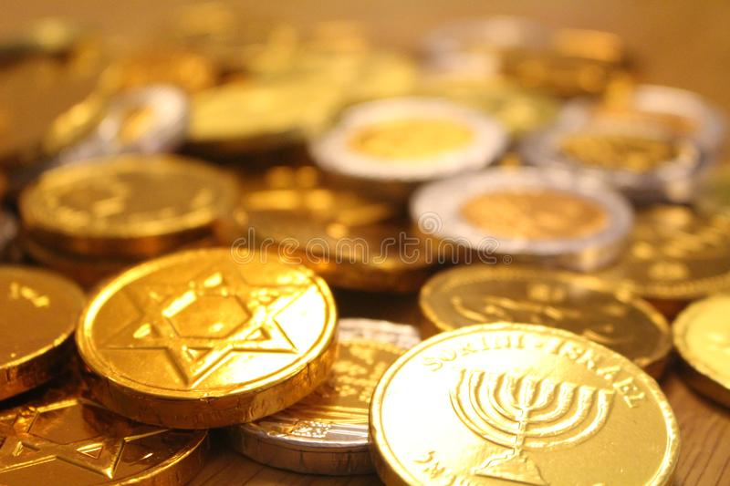 Hanukkah gelt with star of David on back and menorah symbol of Judaism. Hanukkah gelt chocolate coins with star of David on back and menorah symbol of Judaism stock photo