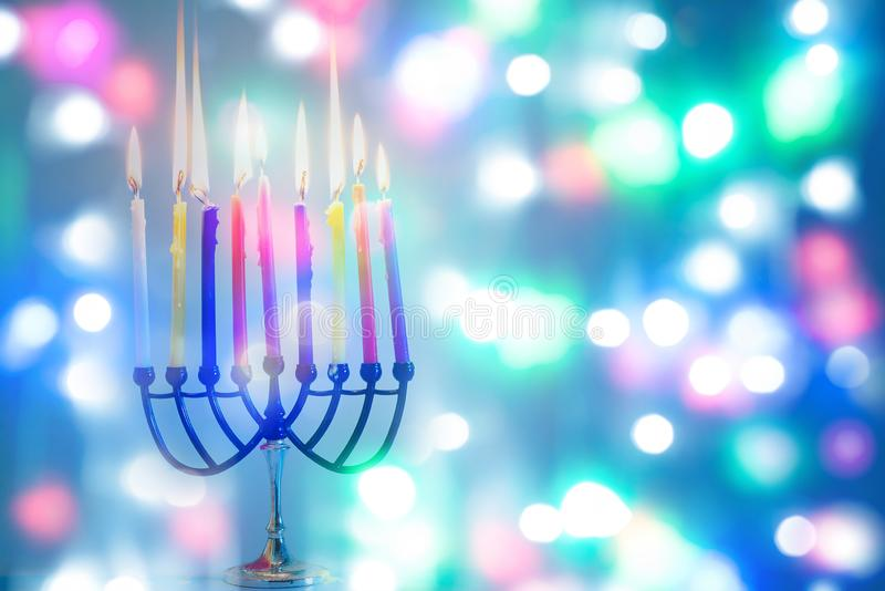 Hanukkah: Holiday Menorah With Variety Of Colorful Lit Candles. stock photo