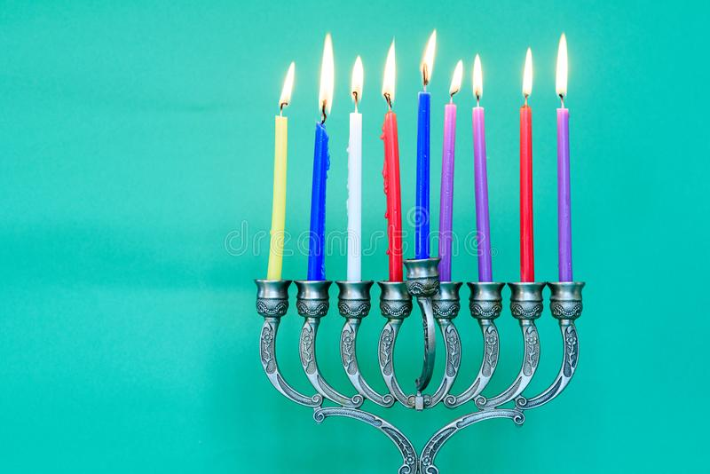 Hanukkah: Holiday Menorah With Variety Of Colorful Lit Candles. royalty free stock images