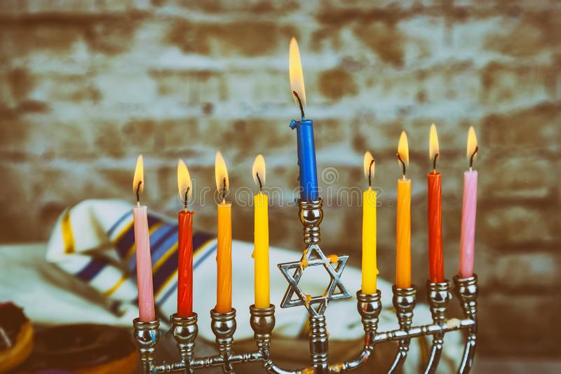 Hanukkah the Jewish Festival of Lights Close up of candle wax melting channukah. royalty free stock image
