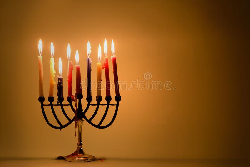 Hanukkah: Holiday Menorah With Variety Of Colorful Lit Candles. royalty free stock photography