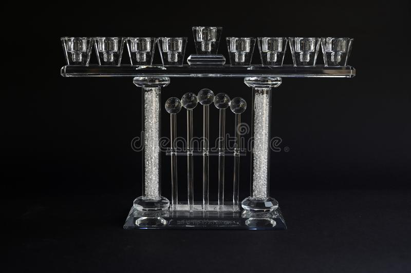 Hanukkah menorah crystal lamp. That is lit for eight days of Hanukkah on a black background royalty free stock image