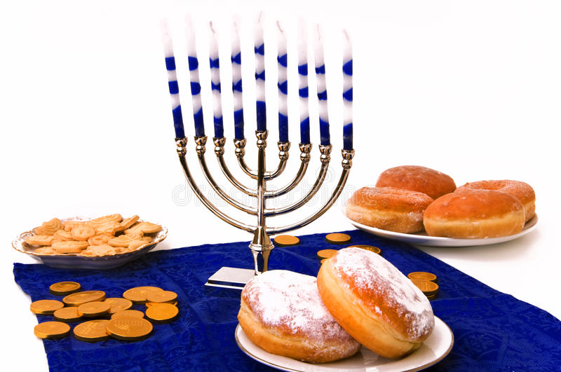 Hanukkah menorah, donuts and coins stock photo