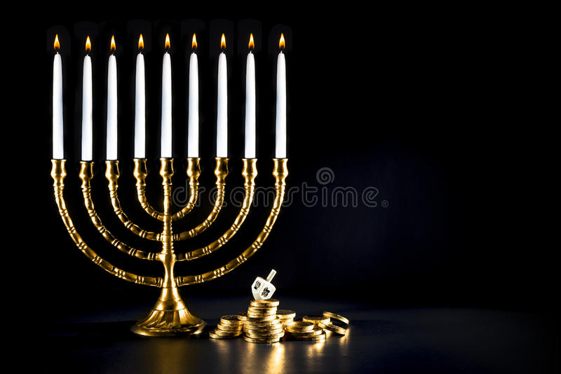 Hanukkah menorah with dreidel and chocolate coins royalty free stock image