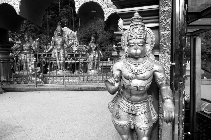 Hanuman Guard at Sita Temple. A closeup black and white image of one of the many monkey Lord Hanuman guards giving the one finger mudras index finger raised at royalty free stock photography