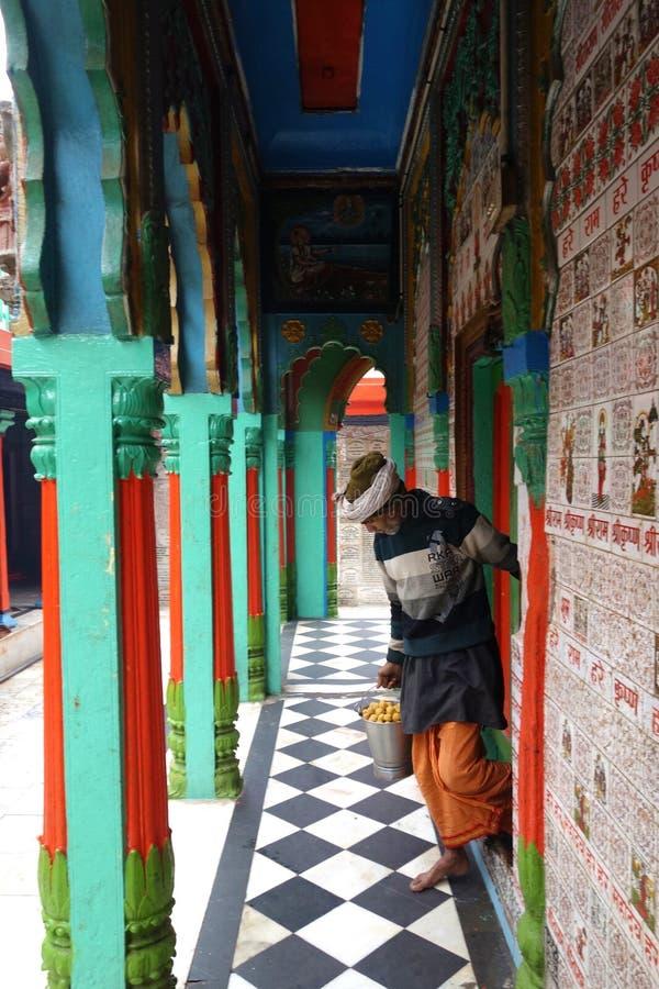 Hanuman Pujari and Laddus stock images