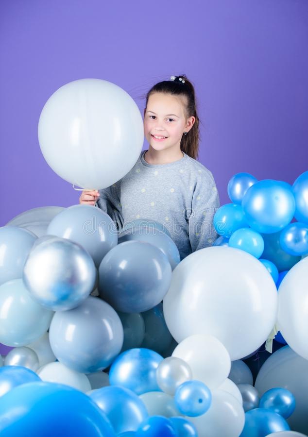 The happiest holiday. Small child. Adorable child with helium balloons. Cute little child with air balloons. Girl child stock images