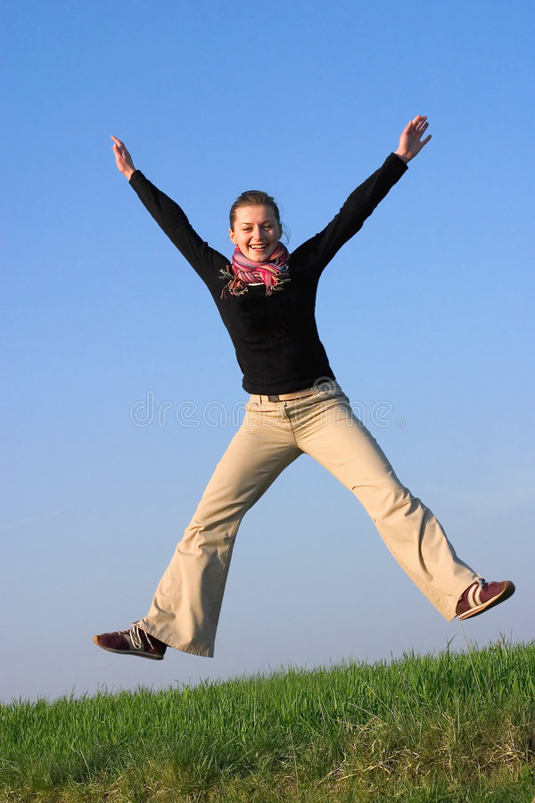 Happily jumping fit attractive woman