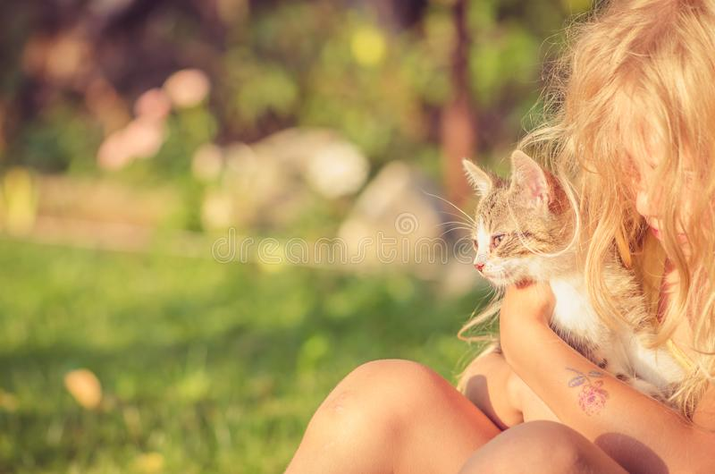 Happines of child and animal in beautiful sunny day stock photography