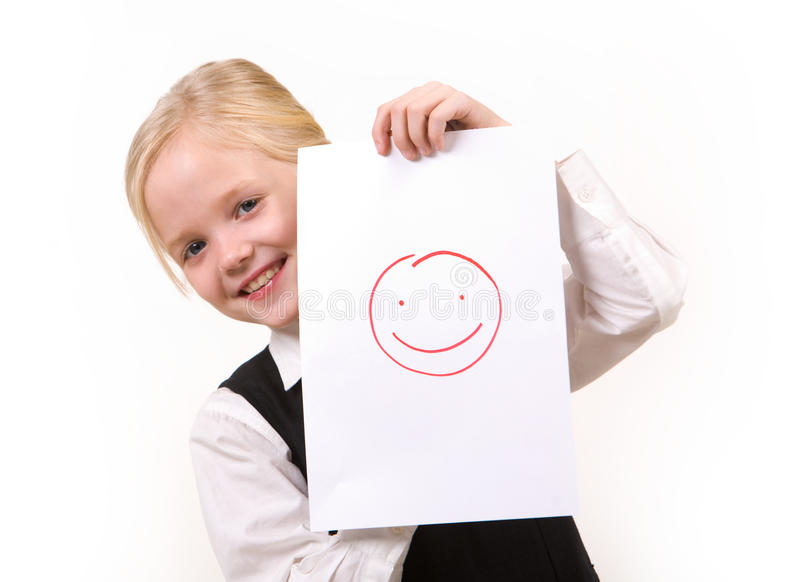 Happiness. Portrait of pretty girl with drawing of happy face looking at camera stock images