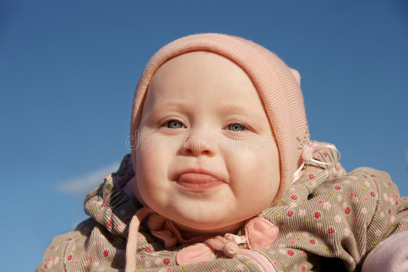 Happiness. Very happy baby girl in blue sky royalty free stock photos