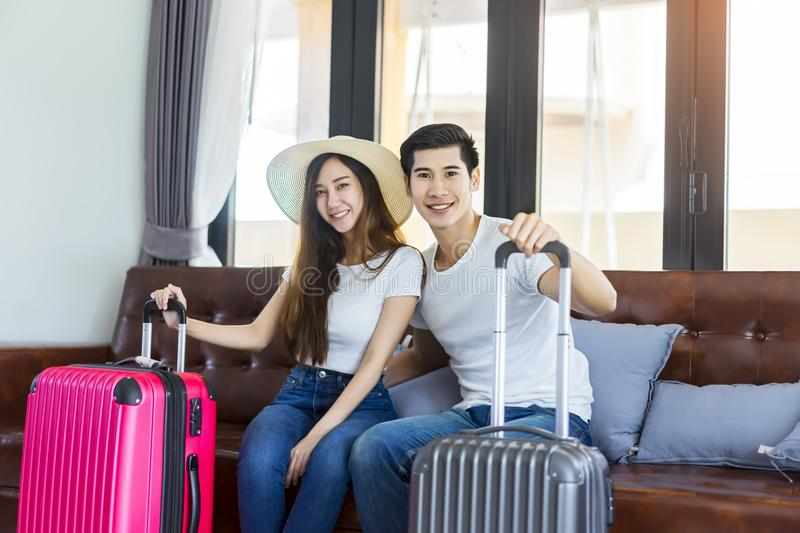 Happiness Asian couple traveler packing suitcases preparing for royalty free stock images