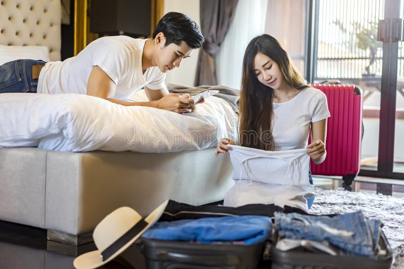 Happiness Asian couple traveler packing suitcases preparing for royalty free stock photos