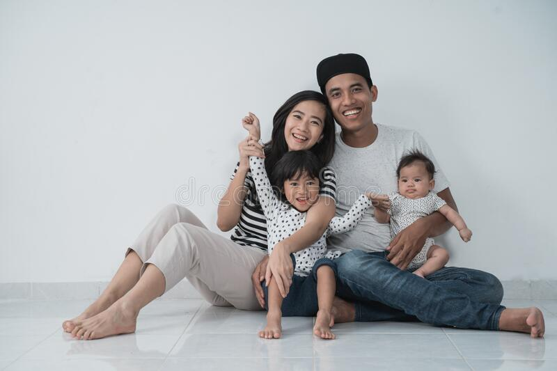 Happiness asian family with two daughter sitting on the floor have fun royalty free stock photos