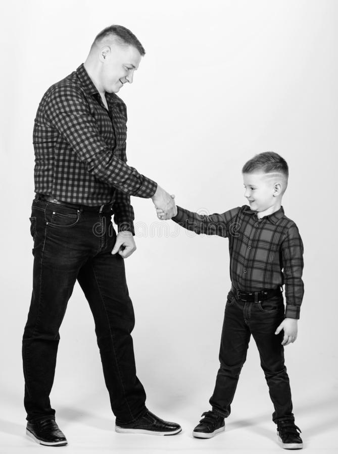 Happiness being father of boy. Dad and adorable child. Parenthood concept. Fathers day. Father example of noble human. Cool guys. Father little son red shirts royalty free stock photos