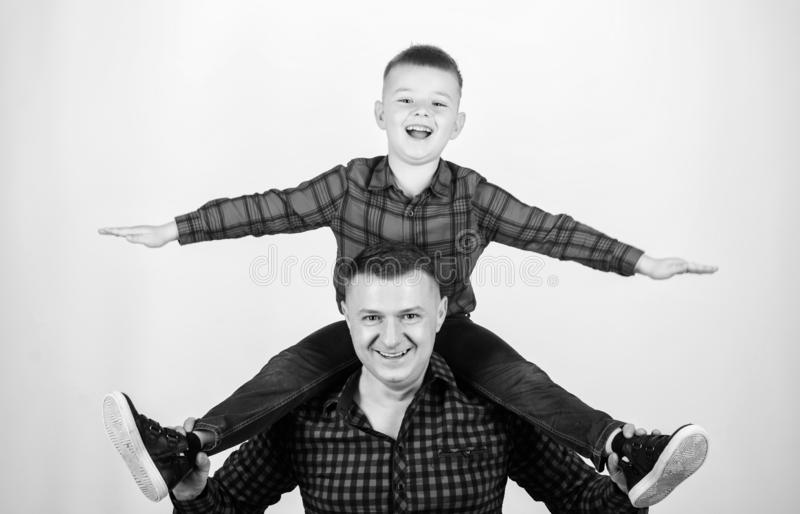 Happiness being father of boy. Having fun. Fathers day. Father example of noble human. Family time. Best friends. Father. Little son red shirts family look royalty free stock photo