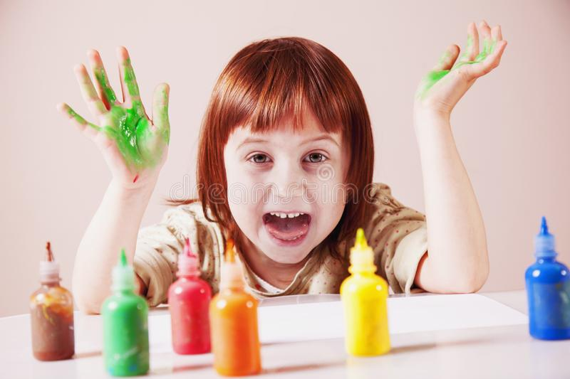 Happiness of child. Little cute girl laughing and painting stock image