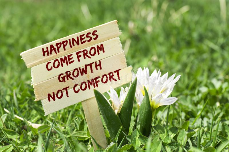 Happiness come from growth not comfort stock image