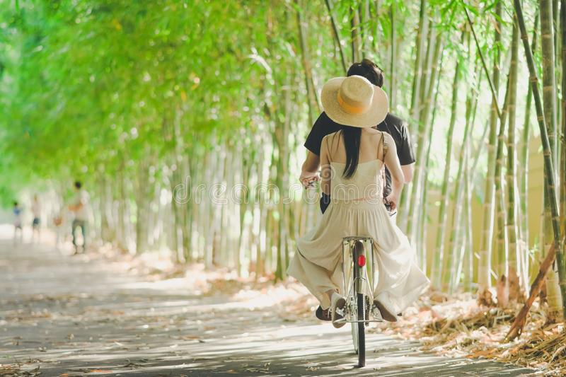 Happiness couple ride a bicycle royalty free stock photography