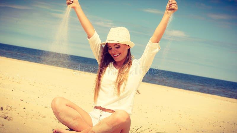 Happy woman on summer beach. stock image