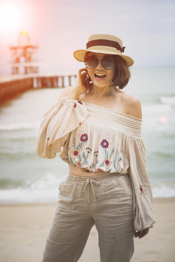 Happiness emotion of young woman standing at vacation sea side stock images