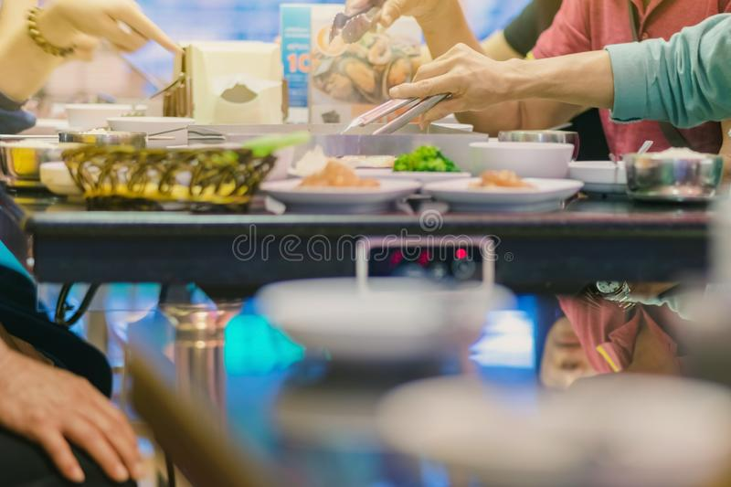 Happiness Enjoy eating Korean BBQ traditional famous food with family royalty free stock image