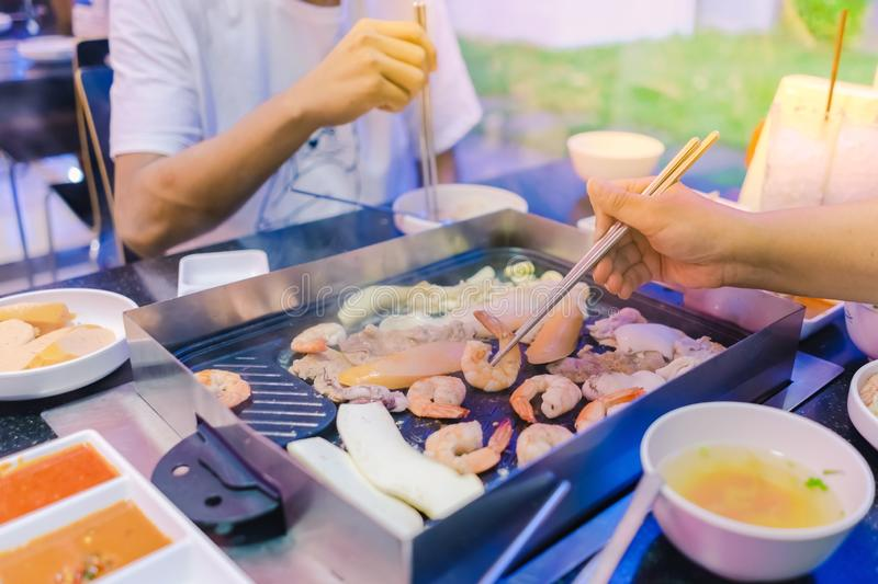 Happiness Enjoy eating Korean BBQ traditional famous food with family royalty free stock photo