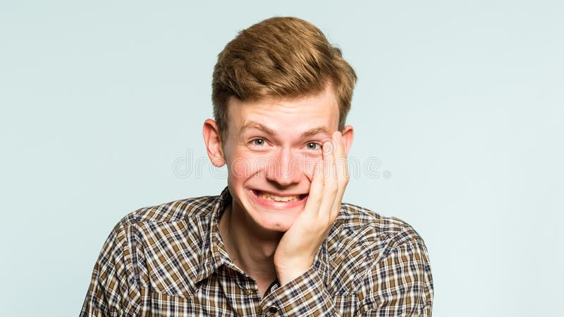 Happiness enjoyment laugh man wide grin emotion. Happiness enjoyment and laugh. man with a wide grin. portrait of a young guy on light background. emotion facial stock photos