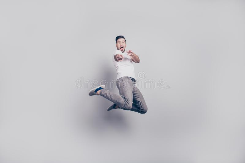 Happiness, freedom, motion and people concept - happy young bear stock photo