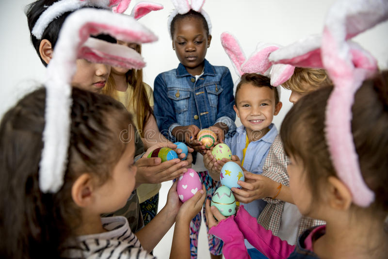 Happiness group of cute and adorable children hunting easter egg stock image
