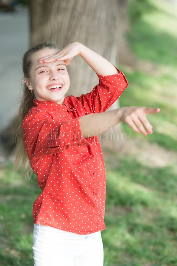 This is happiness. Happy small girl with adorable smiling face pointing at something. Little kid with cute smile shining royalty free stock images