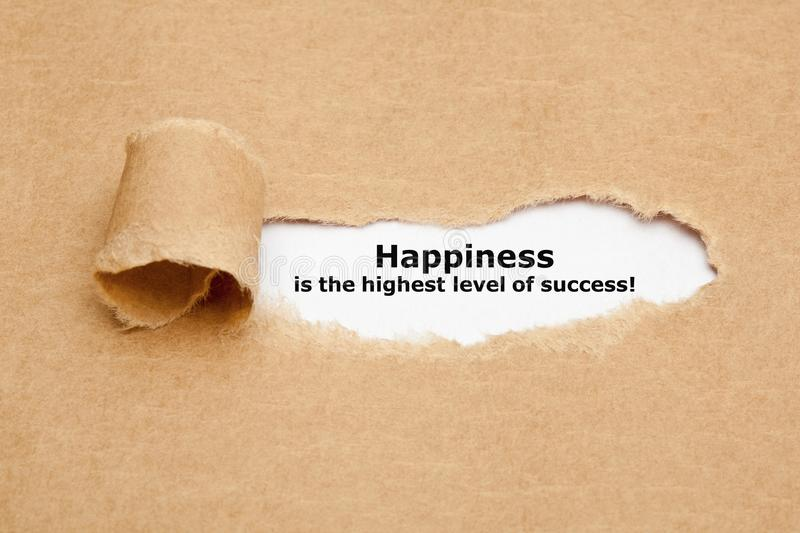 Happiness Is The Highest Level Of Success. Appearing behind torn paper royalty free stock photos